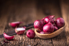 Onion. Red onions on very old oak wood board Stock Images