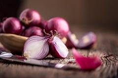 Onion. Red onions on very old oak wood board Stock Photo