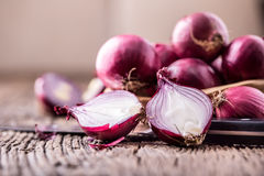 Onion. Red onions on very old oak wood board Stock Image