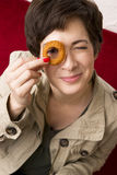 Fun Woman Holds Onion Ring to Eye Smiling Stock Image