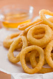 Onion ring with honey sauce Royalty Free Stock Photography