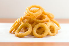 Onion ring on a waxed white paper Royalty Free Stock Photography