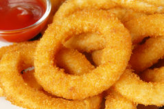 Onion rings. Golden onion rings and ketchup Royalty Free Stock Image
