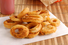 Onion rings. Fresh onion rings on a sheet of white paper Royalty Free Stock Image
