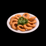 Onion rings on black. Background still life Stock Image