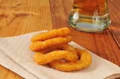 Onion rings. Breaded onion rings with a glass of beer Royalty Free Stock Images