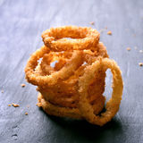 Onion rings on dark background Royalty Free Stock Image
