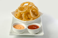 Onion rings and dip sauces Royalty Free Stock Photography