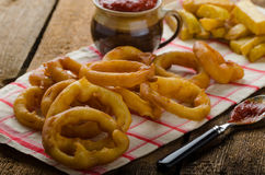 Onion rings, hot dip, french fries and Czech beer Stock Image
