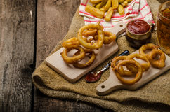 Onion rings, hot dip, french fries and Czech beer Royalty Free Stock Photos