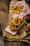 Onion rings, hot dip, french fries and Czech beer Royalty Free Stock Photo