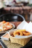 Onion rings italian food. In basket royalty free stock photos