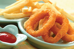 Onion rings with ketchup Royalty Free Stock Photo