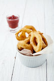 Onion rings with ketchup Stock Photo