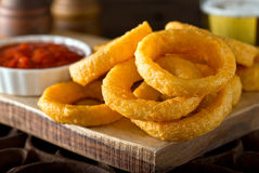 Onion Rings with Ketchup. Delicious pub style onion rings with ketchup and beer Stock Photos