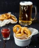 Onion rings, ketchup, sea salt, beer Stock Images