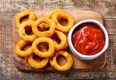 Onion rings with ketchup Royalty Free Stock Photos
