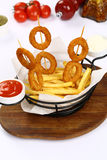 Onion rings and Mixed French Fries. Mixed French Fries and Onion rings Royalty Free Stock Images