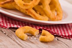 Onion rings. Onion rings with ketchup on white dish royalty free stock photo
