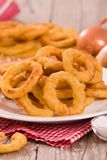 Onion rings. Onion rings on white dish stock photo