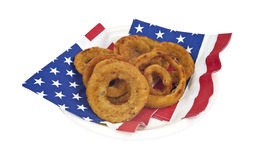 Onion rings on plate and napkins Stock Images