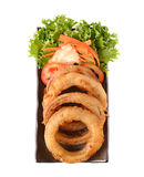 Onion rings on a plate Royalty Free Stock Image