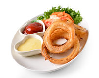 Onion rings on a plate Stock Photos