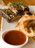 Onion Rings and Ribs Stock Photography