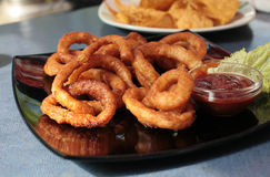 Onion rings with sauce Stock Image