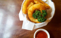Onion Rings with tomatoes ketchup. Royalty Free Stock Image