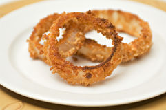 Onion rings on white plate Royalty Free Stock Photos
