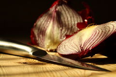 Onion sliced knife A Royalty Free Stock Images