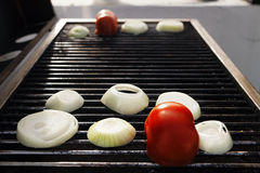 Tomato &  Onions on the Grill Royalty Free Stock Photo