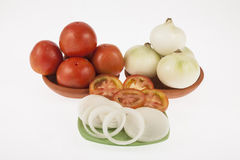 Onion slices and tomato slices. On neutral background Stock Images