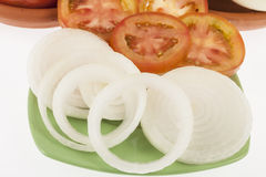 Onion slices and tomato slices. On neutral background Stock Photo