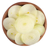 Onion slices in a wooden bowl on a white Stock Photos