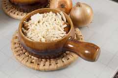 Onion soup. Arrangement of two bowls of onion soup and fresh onions stock image
