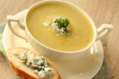 Onion soup with celery and sliced bread with blue cheese Royalty Free Stock Images