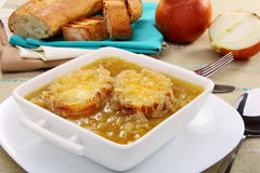 Onion soup with croutons. Stock Photo