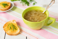 Onion soup in green bowl Stock Images