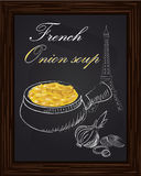 Onion soup and onion on a eiffel tower background Royalty Free Stock Photos