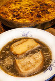 Onion soup and quiche pie Stock Photos