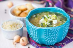 Onion soup with rice, feta cheese, zucchini, croutons, tasty dis Royalty Free Stock Image