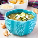 Onion soup with rice, feta cheese, zucchini, croutons, tasty Stock Images