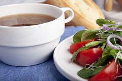 Onion Soup and Salad Royalty Free Stock Photography