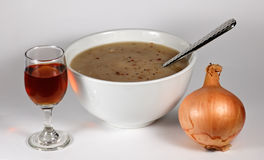 Onion Soup and Sherry. Bowl of onion soup and a glass of sherry Stock Photos