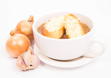 Onion soup. With toast on a white background with some onions and garlic Royalty Free Stock Photos