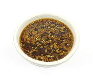 Onion soup in white bowl Stock Photo