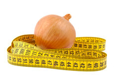 Onion and tape measure Royalty Free Stock Photos