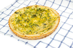 Onion tart on a plate with Royalty Free Stock Photography